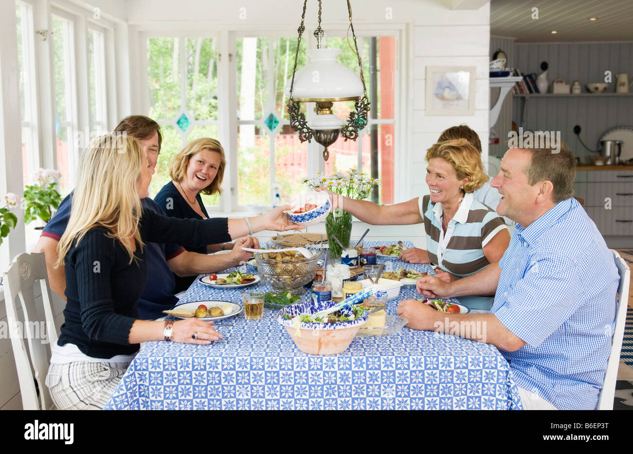 Dinner party with six people - Stock Image