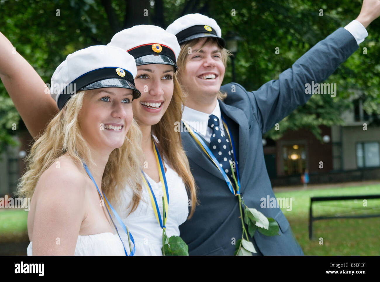 Students with raised arms - Stock Image