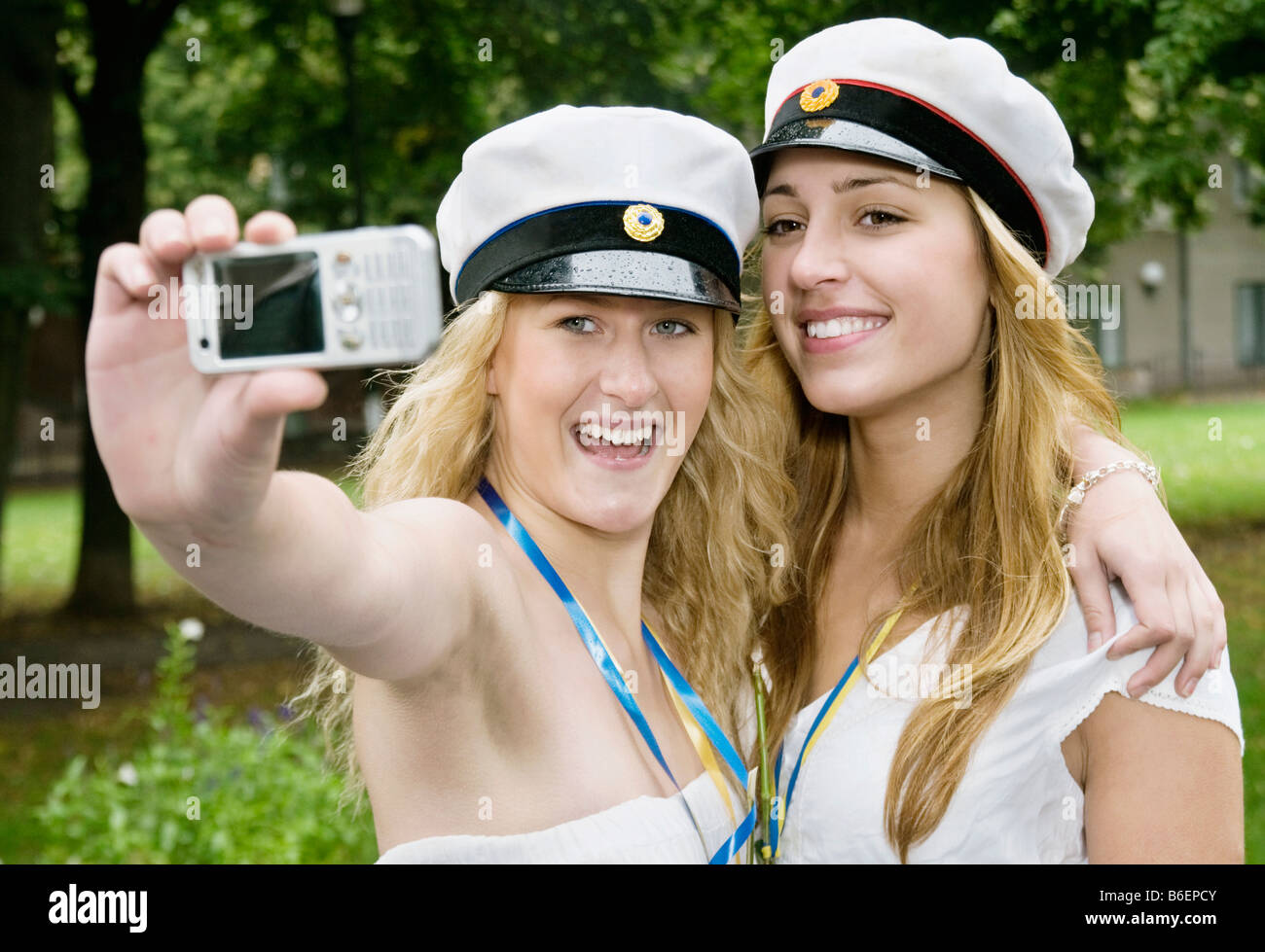 Female students taking picture - Stock Image