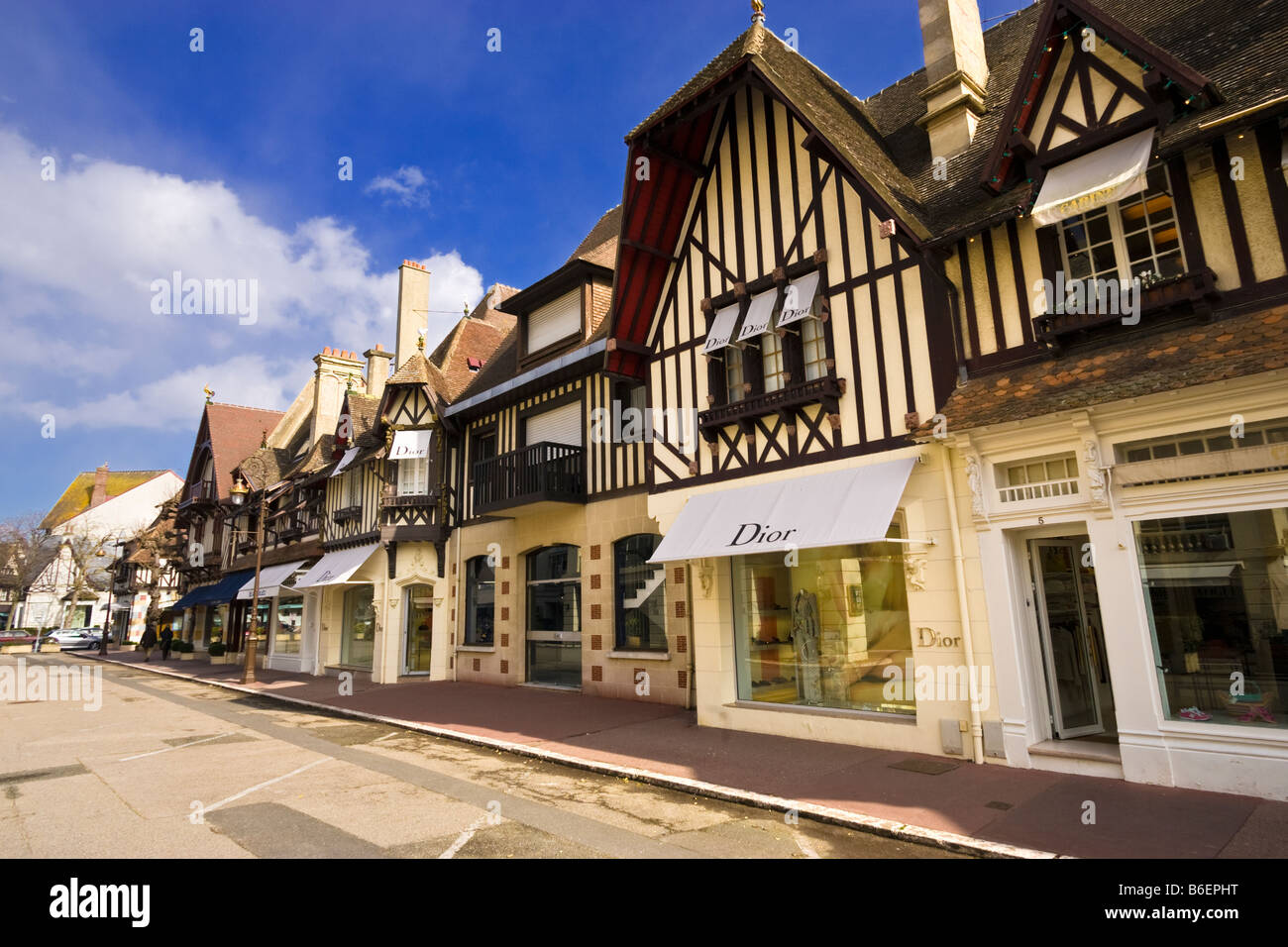 Deauville, Normandy, France - Christian Dior retail store and other luxury stores in the upscale resort town - Stock Image