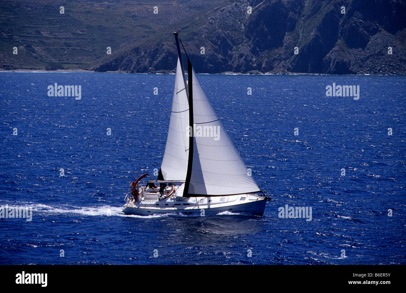 Yacht in front of the coast of the island of Paros, Greece, Europe - Stock Image
