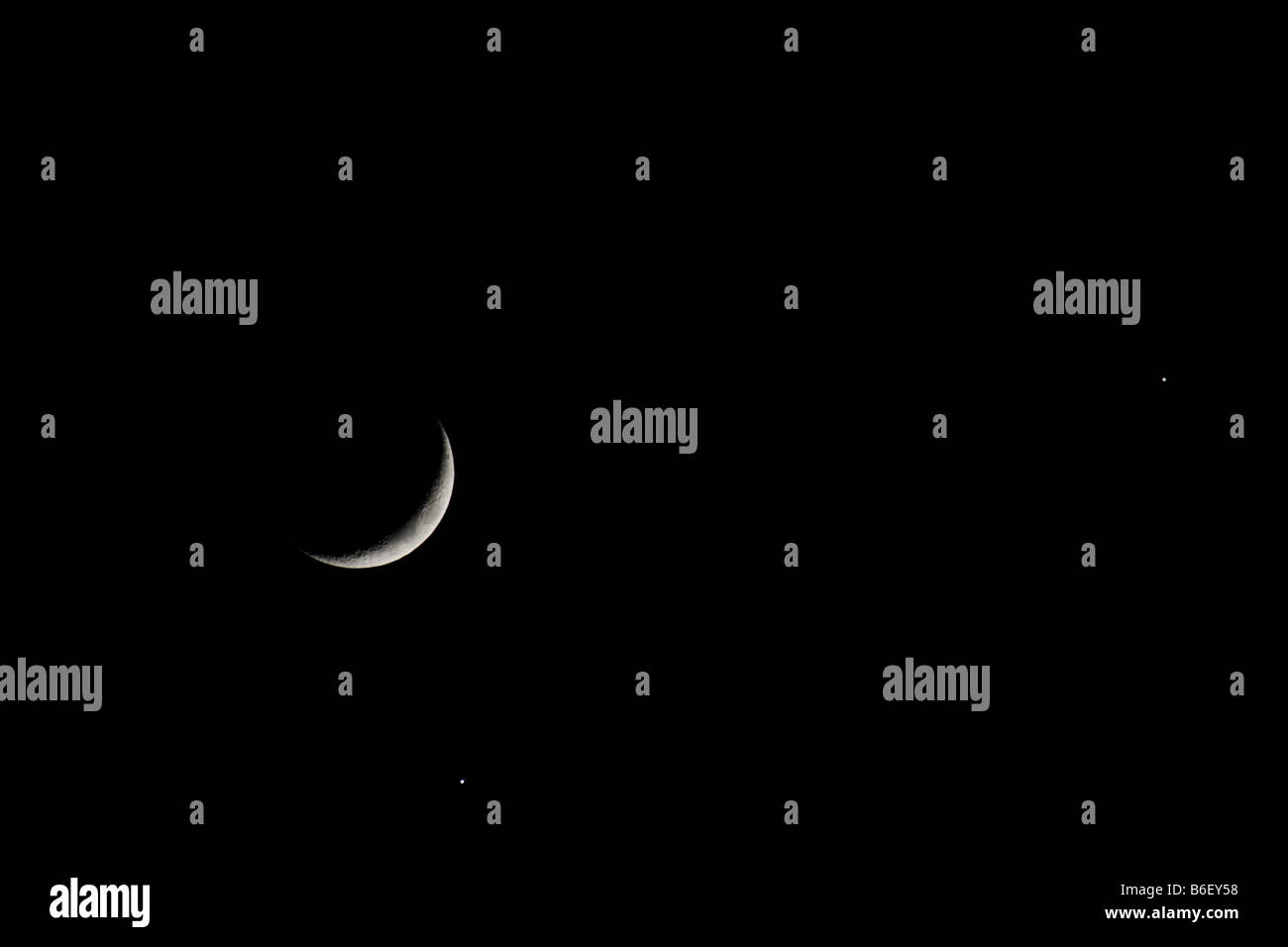 1 Dec 2008 a rare planetary conjunction of Venus and Jupiter appearing close to the moon as viewed from Lisbn Portugal - Stock Image