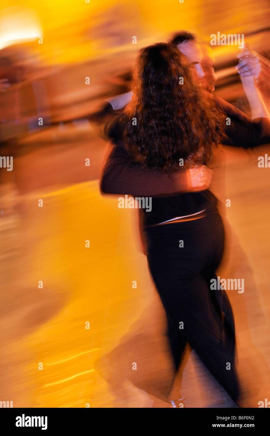 Tango dancing partners at a tango event, Milonga, on the Plaza Dorrego Square, Barrio San Telmo, Buenos Aires, Argentina, - Stock Image
