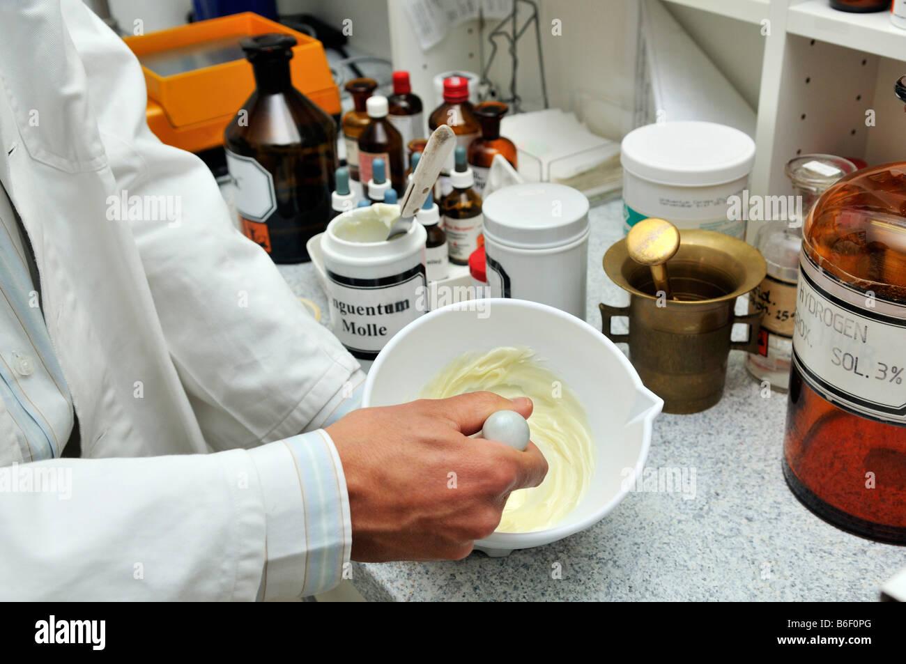 Chemist mixing a salve - Stock Image