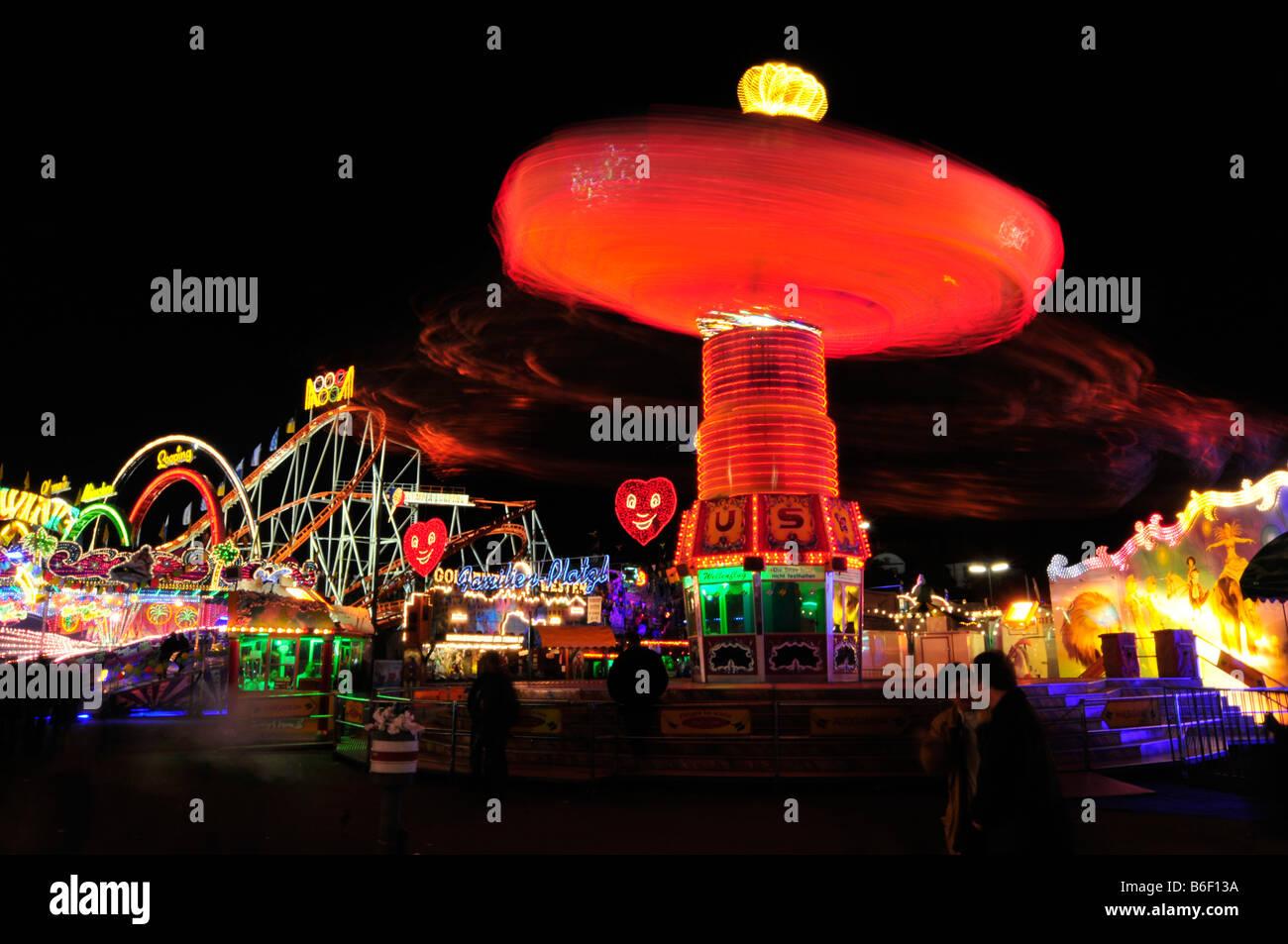 Chain carousel at night, Oktoberfest, Munich, Bavaria, Germany, Europe Stock Photo