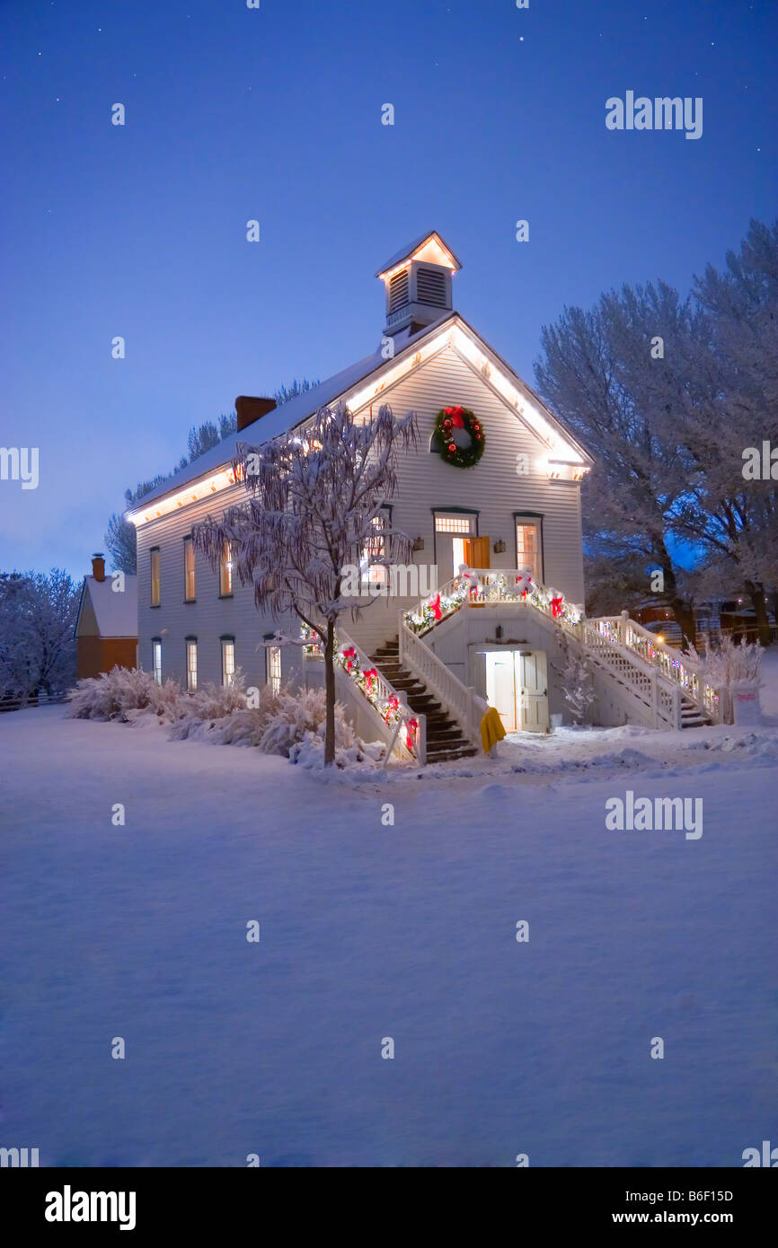 A quaint old pioneer Church with the first stars in the sky at Christmas time in Pioneer Village State Park in Salt Stock Photo