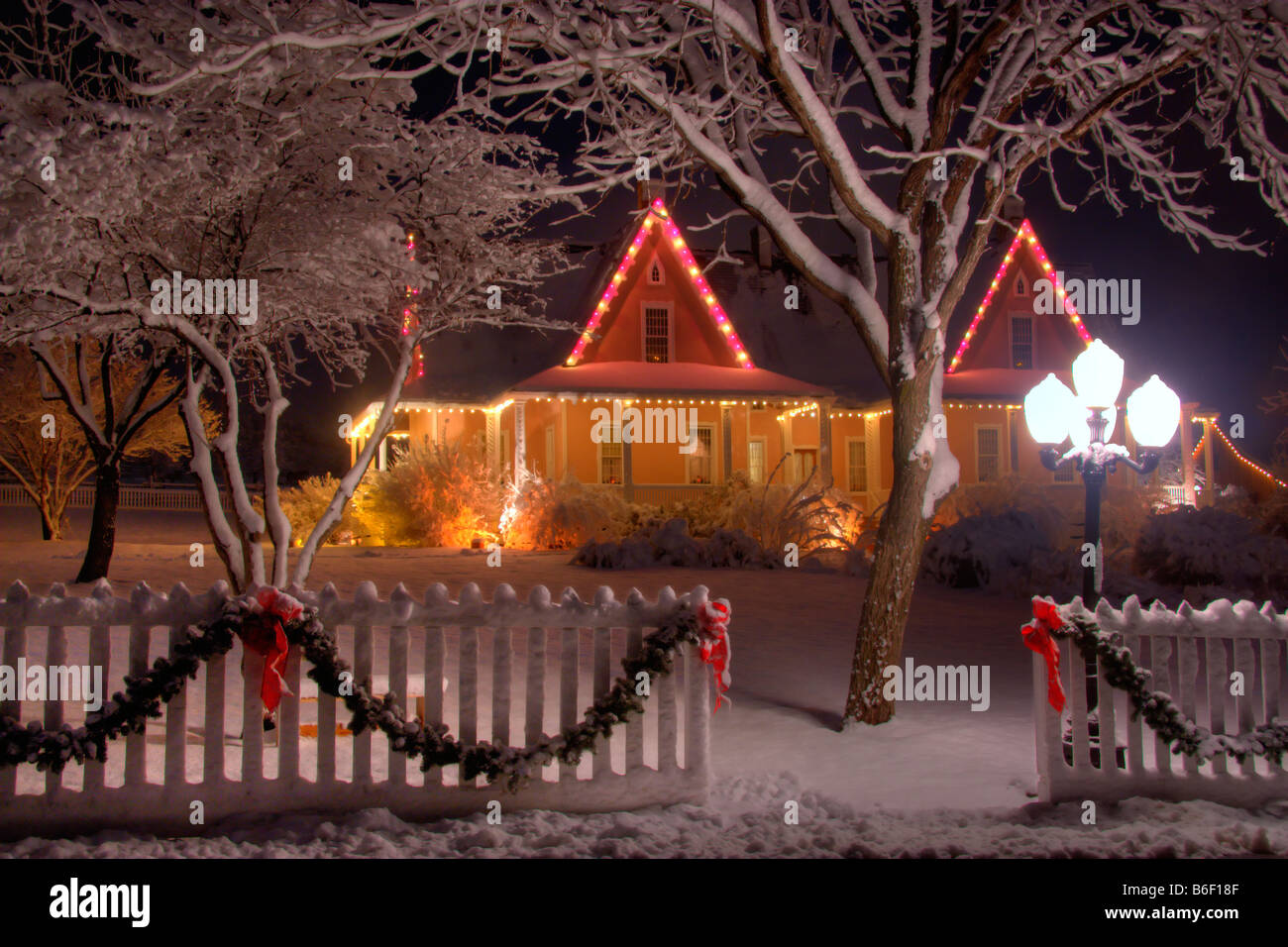 Brigham Young Farmhouse surrounded by snowy trees at Christmas time in Pioneer Village State Park in Salt Lake City Stock Photo