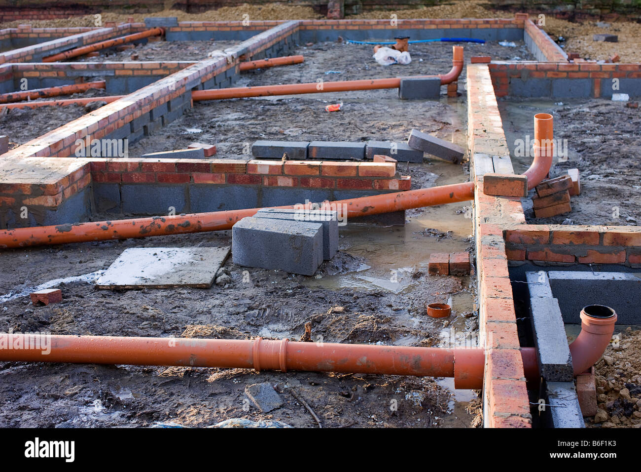 Pipework for drains built into the footings - Stock Image