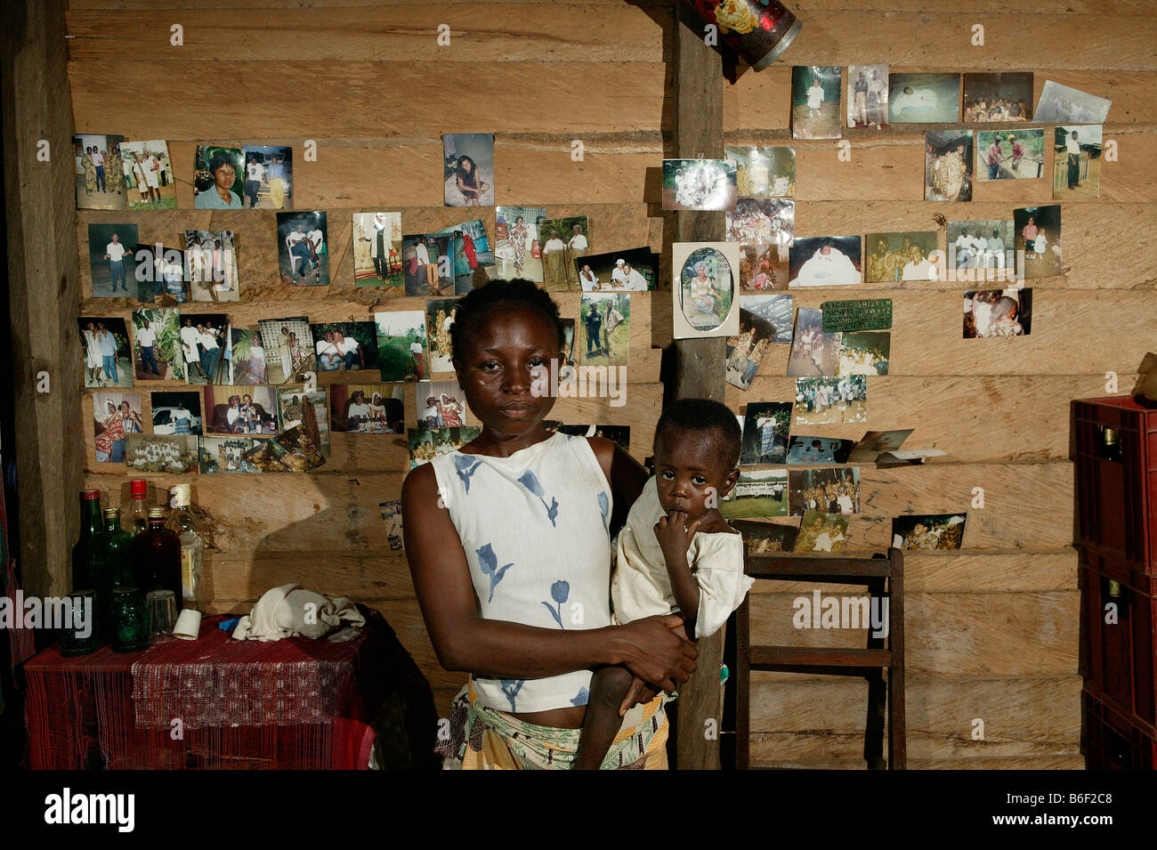 AIDS/HIV positive woman with her child, portrait, in her flat, Manyemen, Cameroon, Africa - Stock Image