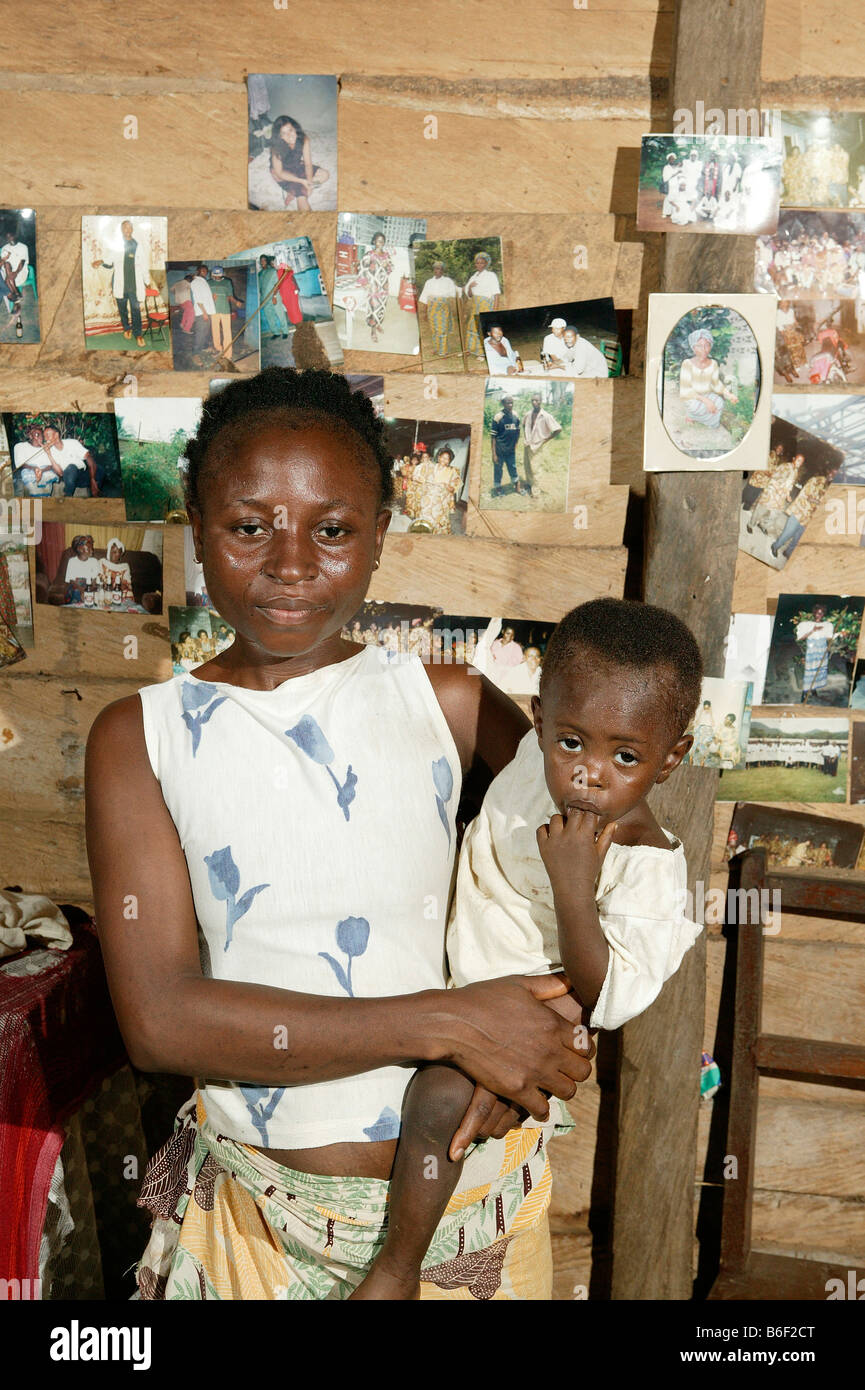AIDS/HIV positive woman with child, portrait, in her flat, Manyemen, Cameroon, Africa - Stock Image