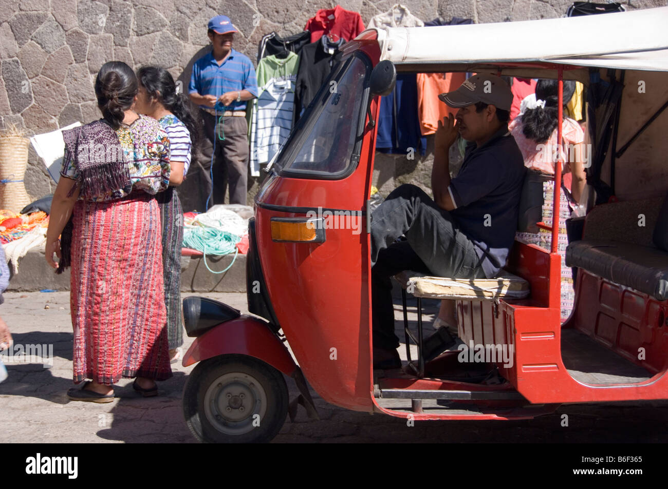 A red tuctuc waiting for customers on the market of Santiago Atitlan, Guatemala. - Stock Image