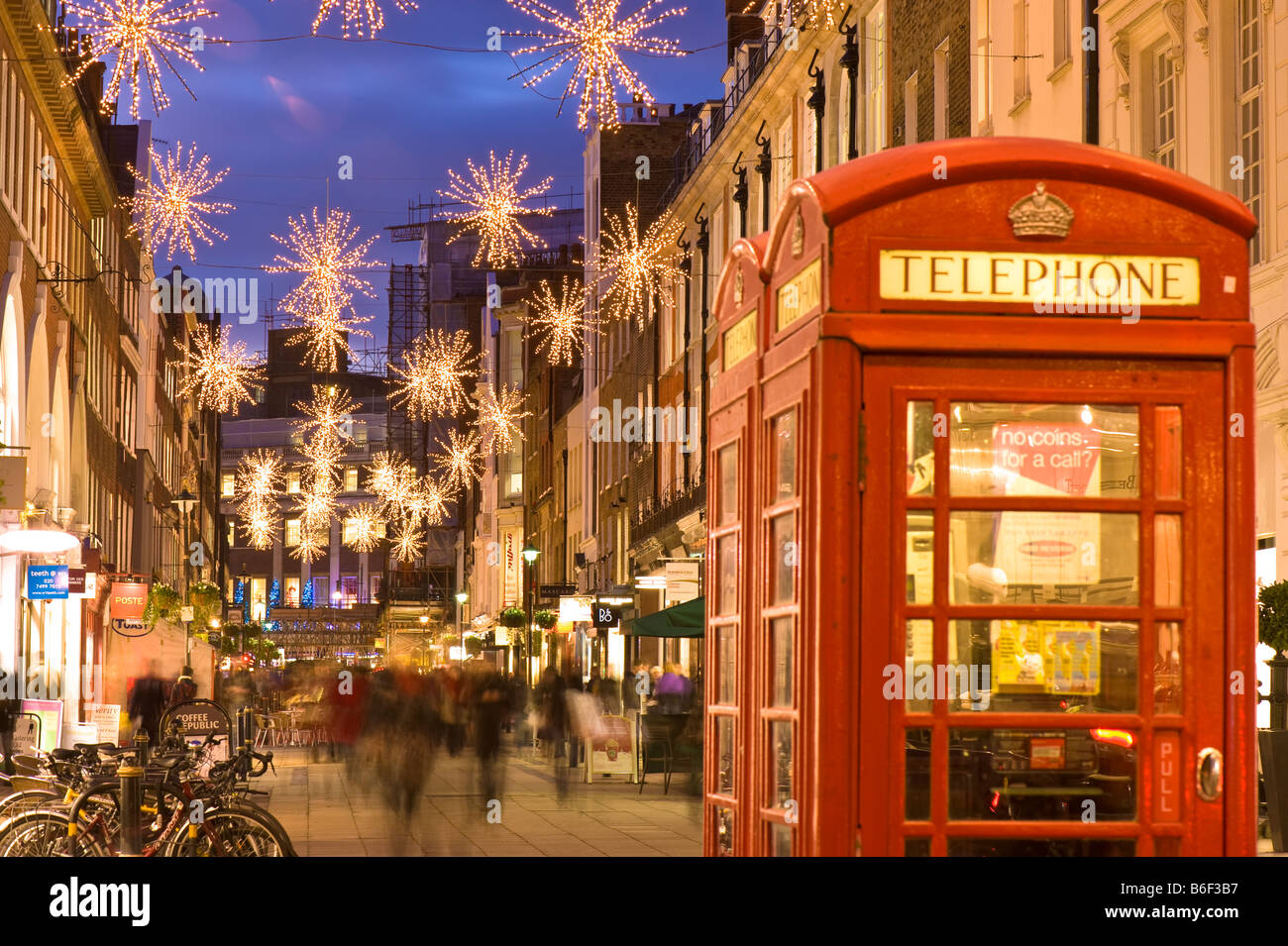 People shopping Christmas time South Molton Street W1 London United Kingdom - Stock Image