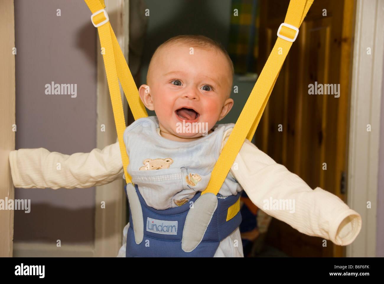 3f9e8dc37 Baby In Door Bouncer Stock Photos   Baby In Door Bouncer Stock ...