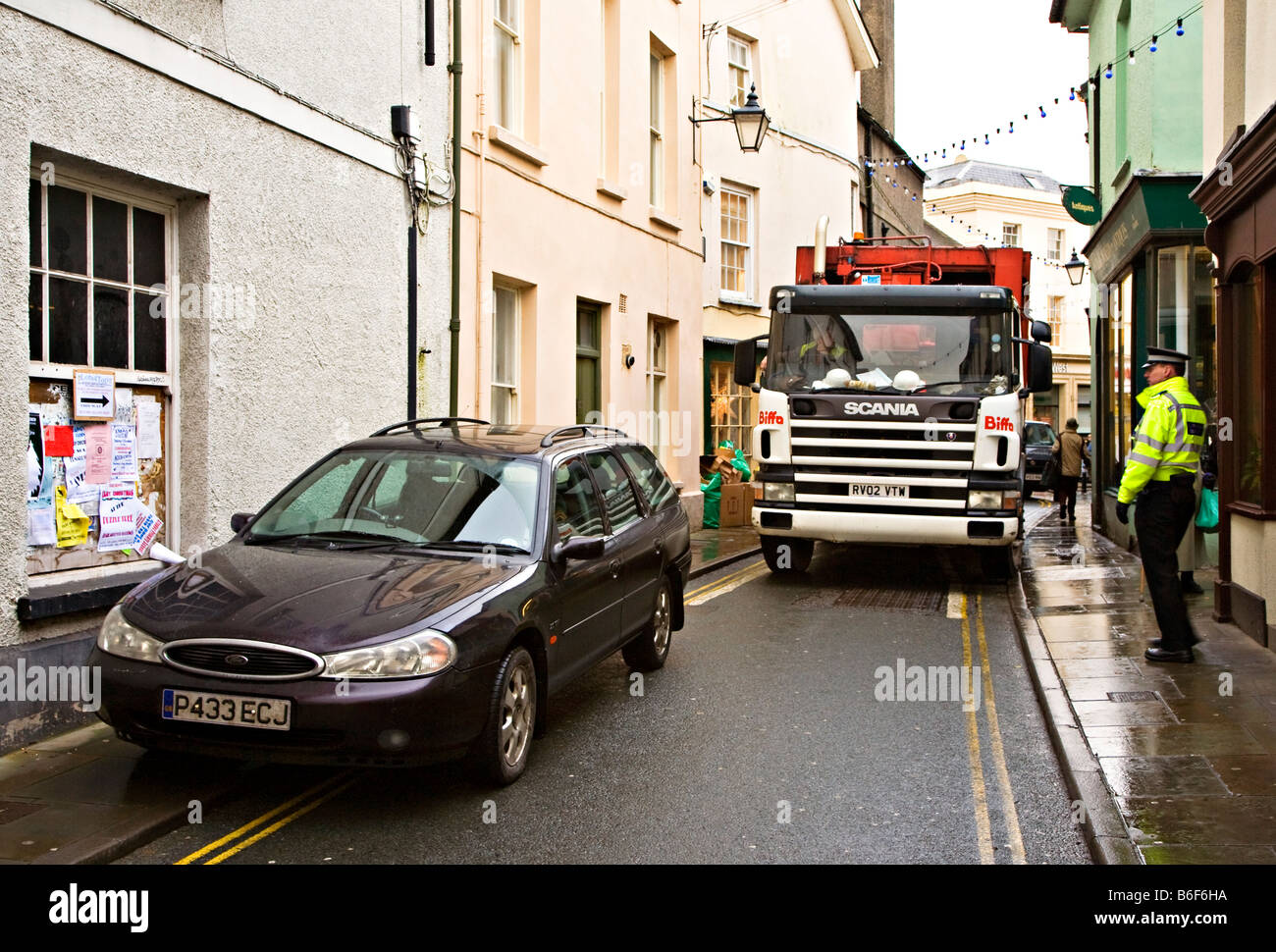 Car parked on double yellow lines in no waiting zone blocking road with police attending Brecon Wales UK - Stock Image