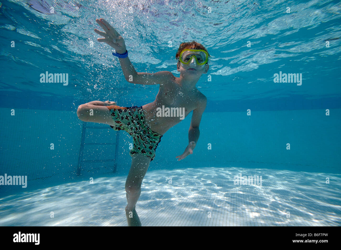 6 Year Old Boy Wearing Diving Goggles Diving In A Swimming Pool Stock Photo 21233713 Alamy
