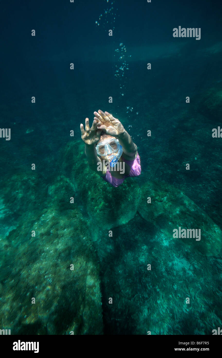 Woman with a snorkel and diving goggles scuba diving in the sea, underwater picture, Villasimius, Sardinia, Italy, - Stock Image