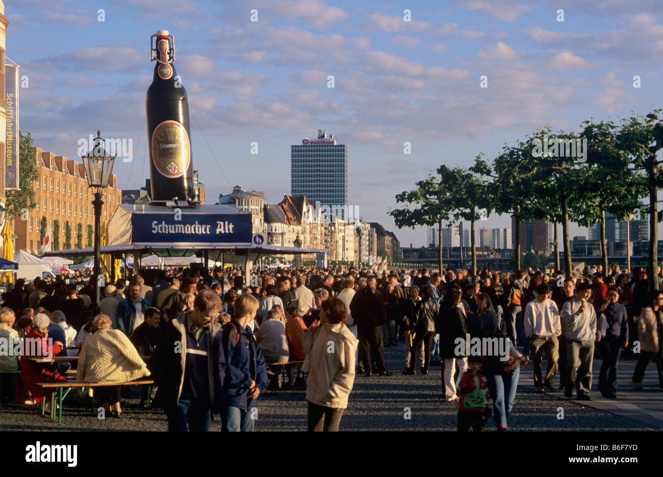 People enjoying the fine weather on the Rheinuferpromenade or Rhine Bank Promenade in the provincial capital of - Stock Image