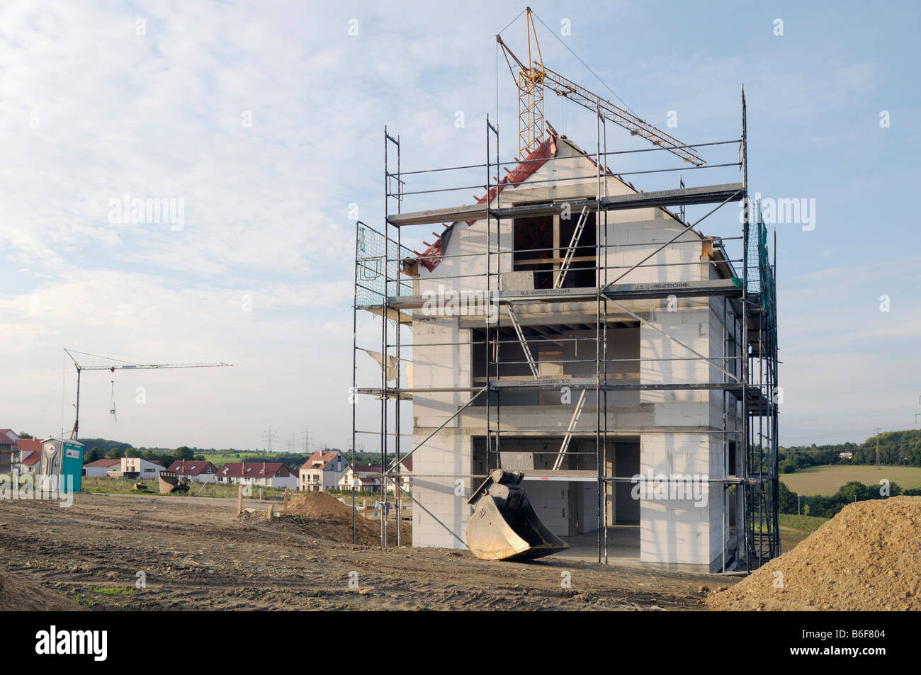Scaffold covered house-shell, new estate - Stock Image