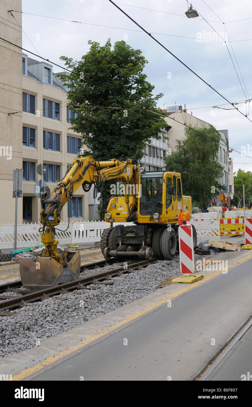 Construction site, tram track construction work, special digger on the rails - Stock Image