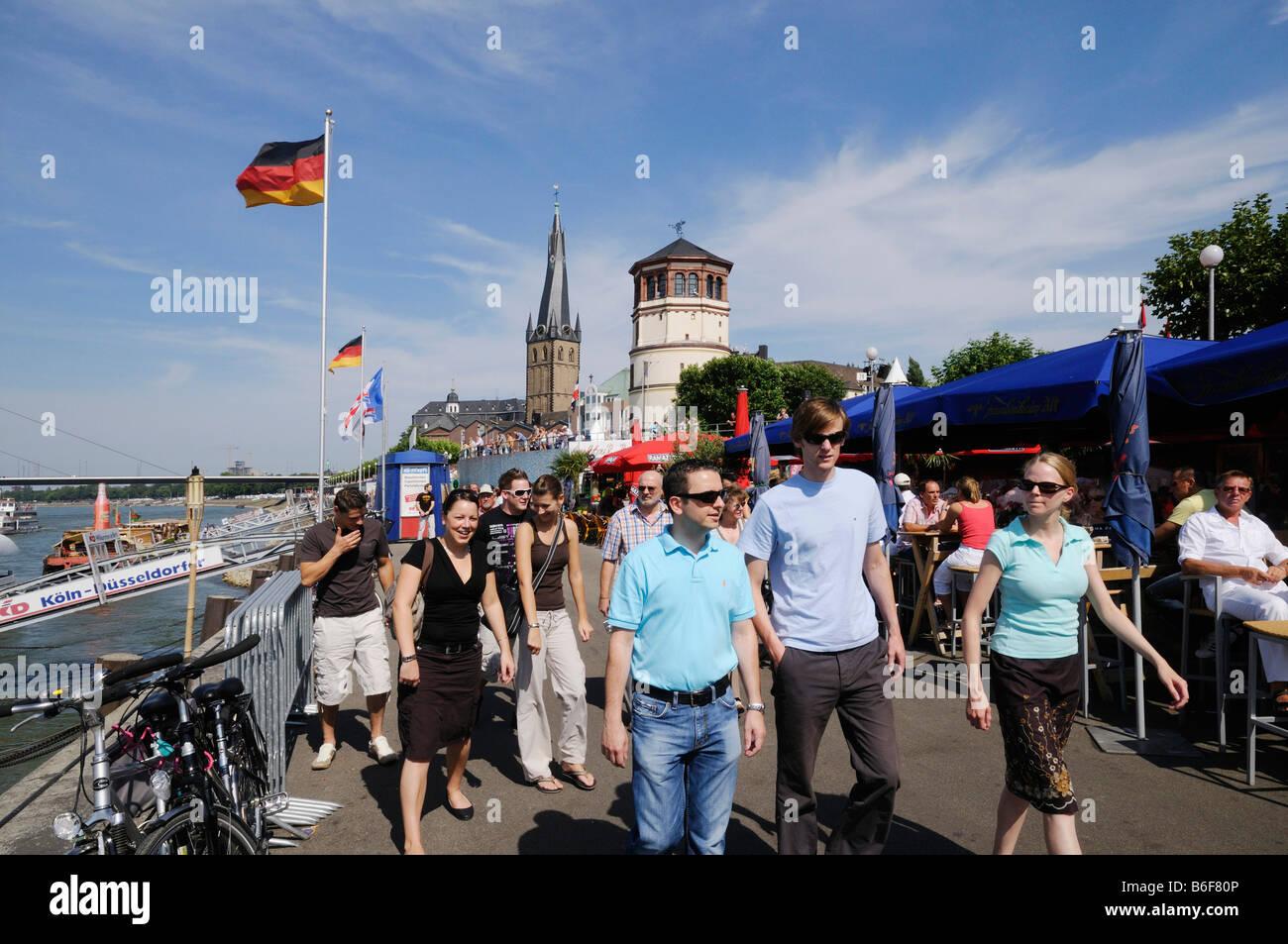 Young people on Duesseldorf's Rhine River waterside promenade, Duesseldorf, North Rhine-Westphalia, Germany, - Stock Image