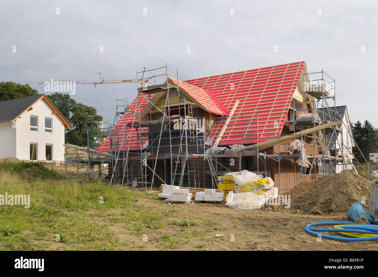 Residential houses, new construction surrounded by scaffolding with dormer roof, North Rhine-Westphalia, Germany, - Stock Image