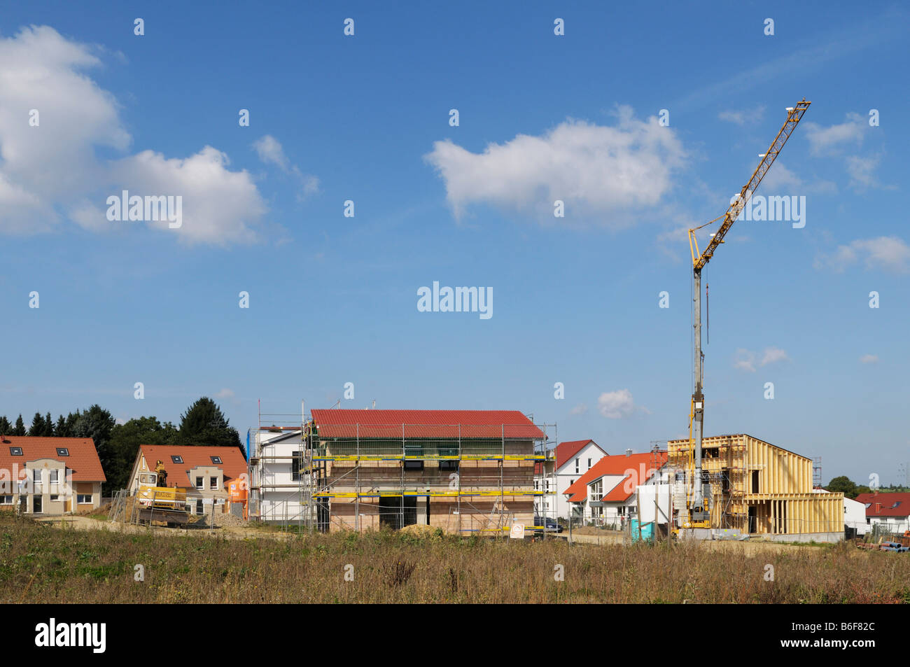 Development area, different houses in different stages of completion, including a timber building, Mettmann, North - Stock Image