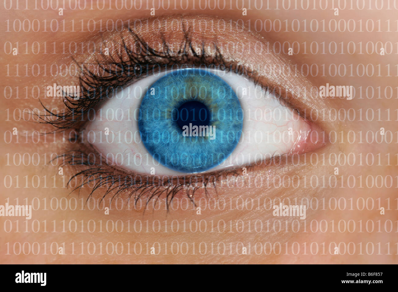 Close-up of binary code covering an eye with a light blue iris, symbolizing the collection of personal data Stock Photo