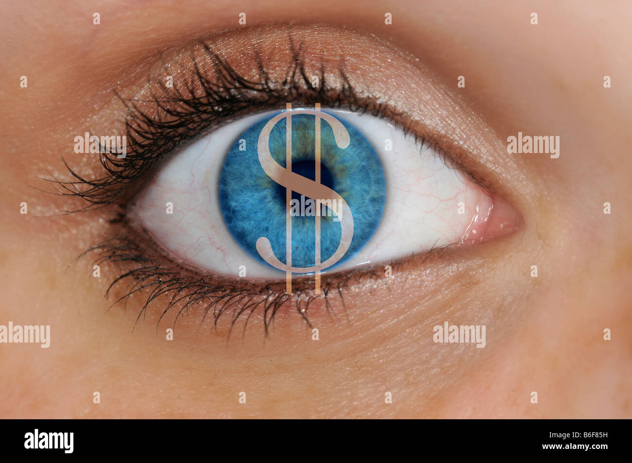 Close-up of a dollar sign over an eye with a light blue iris, symbolizing greed - Stock Image