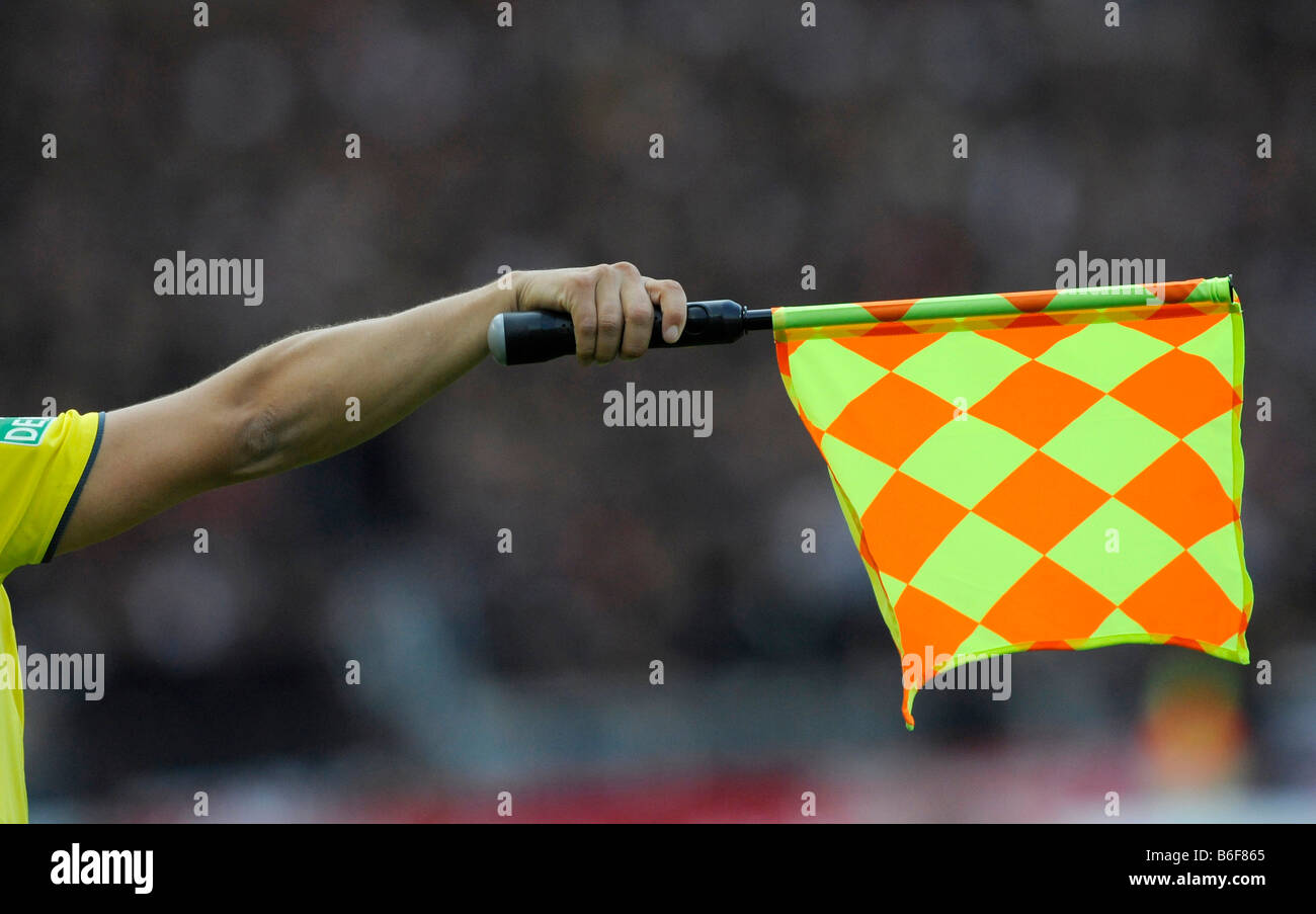 Linesman holding a flag, football - Stock Image