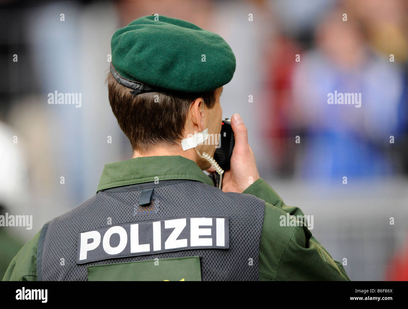 Riot policeman with a radio - Stock Image