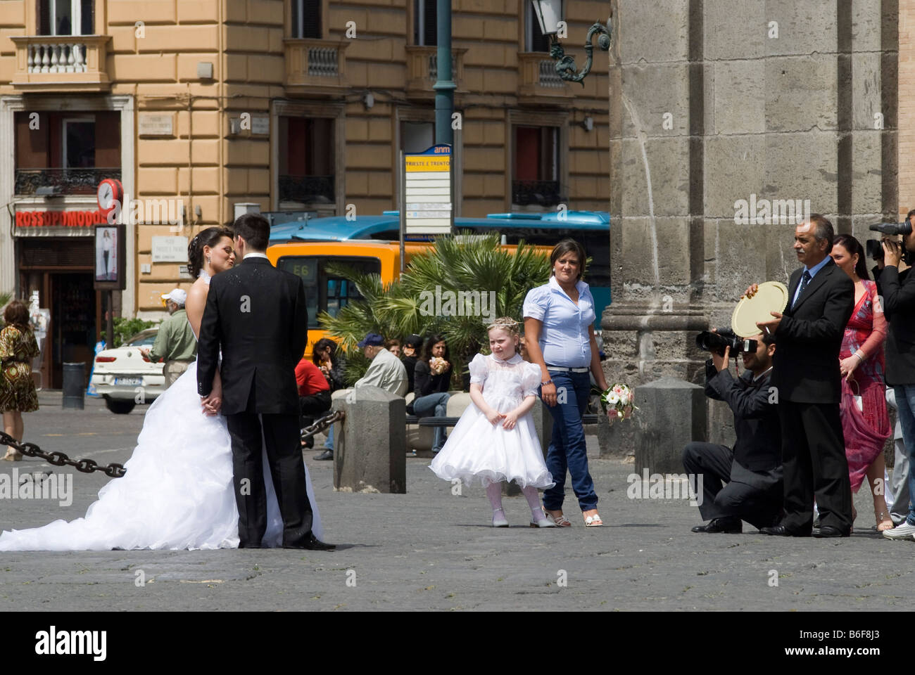 Bride and groom being photographed by their video and stills photographer on the Piazza Plebescito in front of the - Stock Image