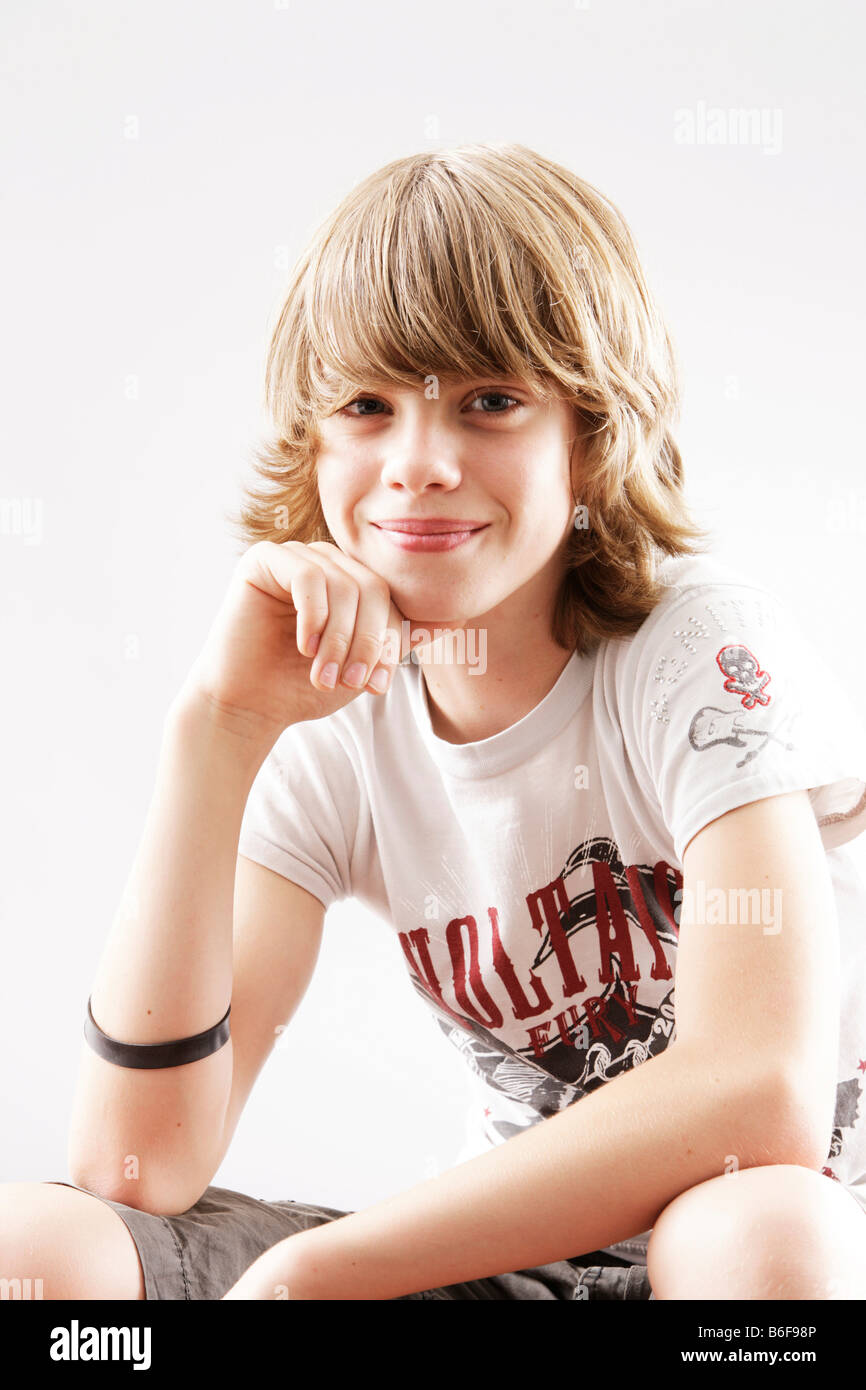 12 Year-old Boy Looking Into The Camera, Smiling Stock