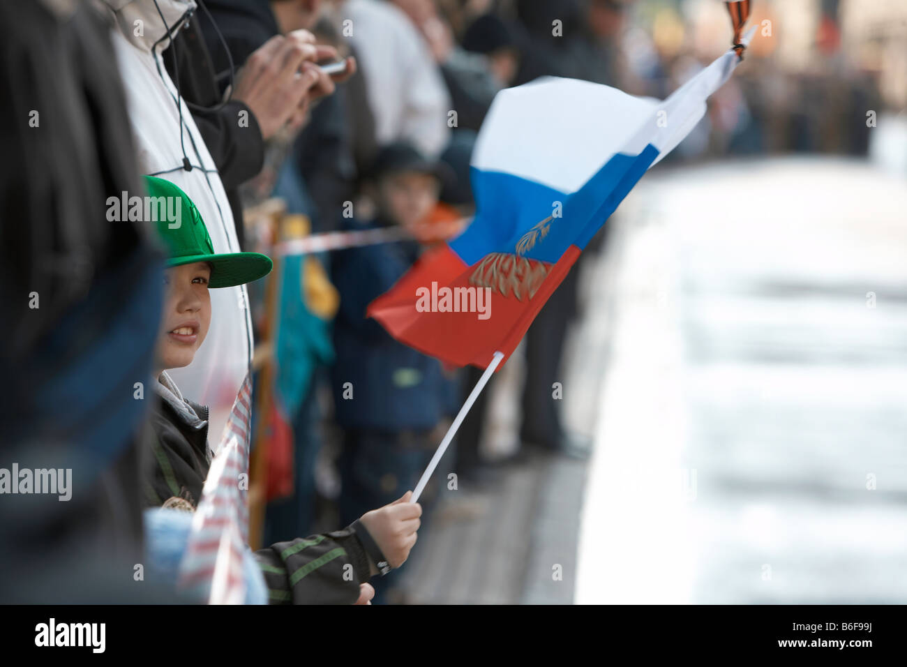 Crowds waving flags during Victory Day Celebration, Moscow Russia - Stock Image