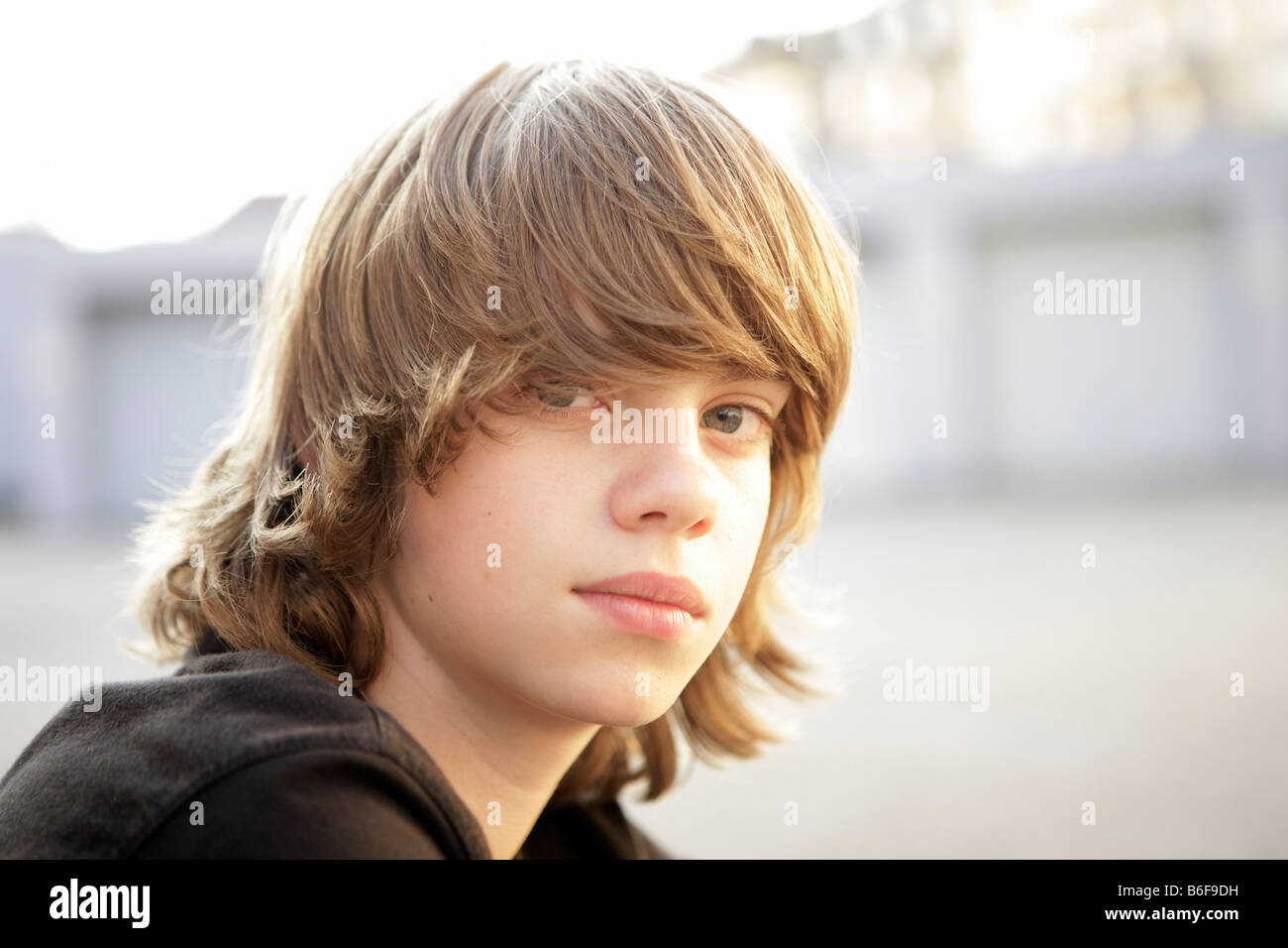 Boy, 12, with blond hair - Stock Image