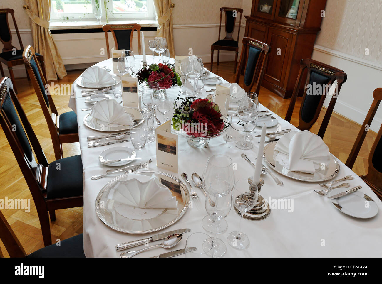 Banquet table set for six people in the Biedermeierzimmer or Biedermeier Room of the Krickenbeck moated castle, Stock Photo