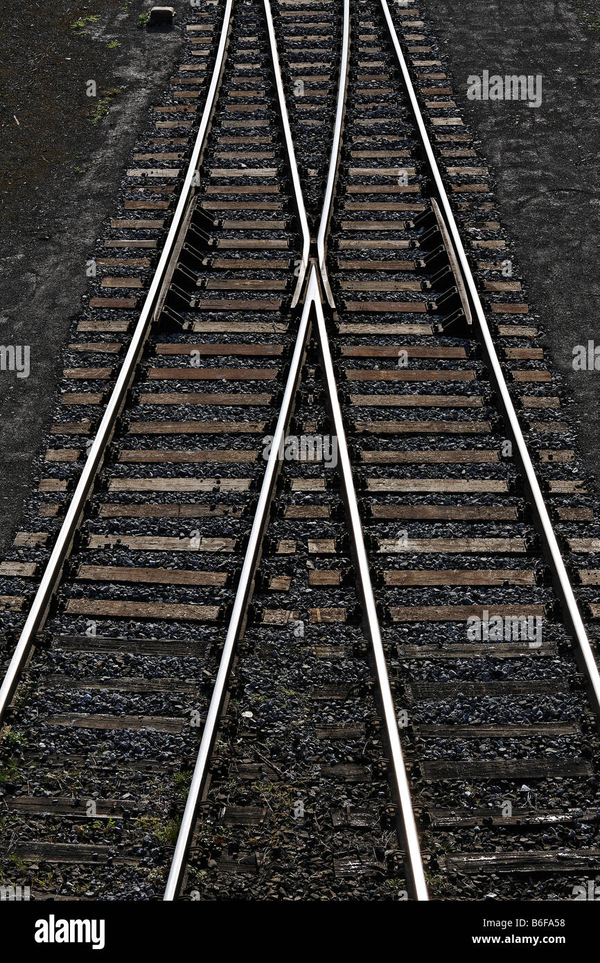 Railway tracks with a switch joining two tracks into one, view from above Stock Photo