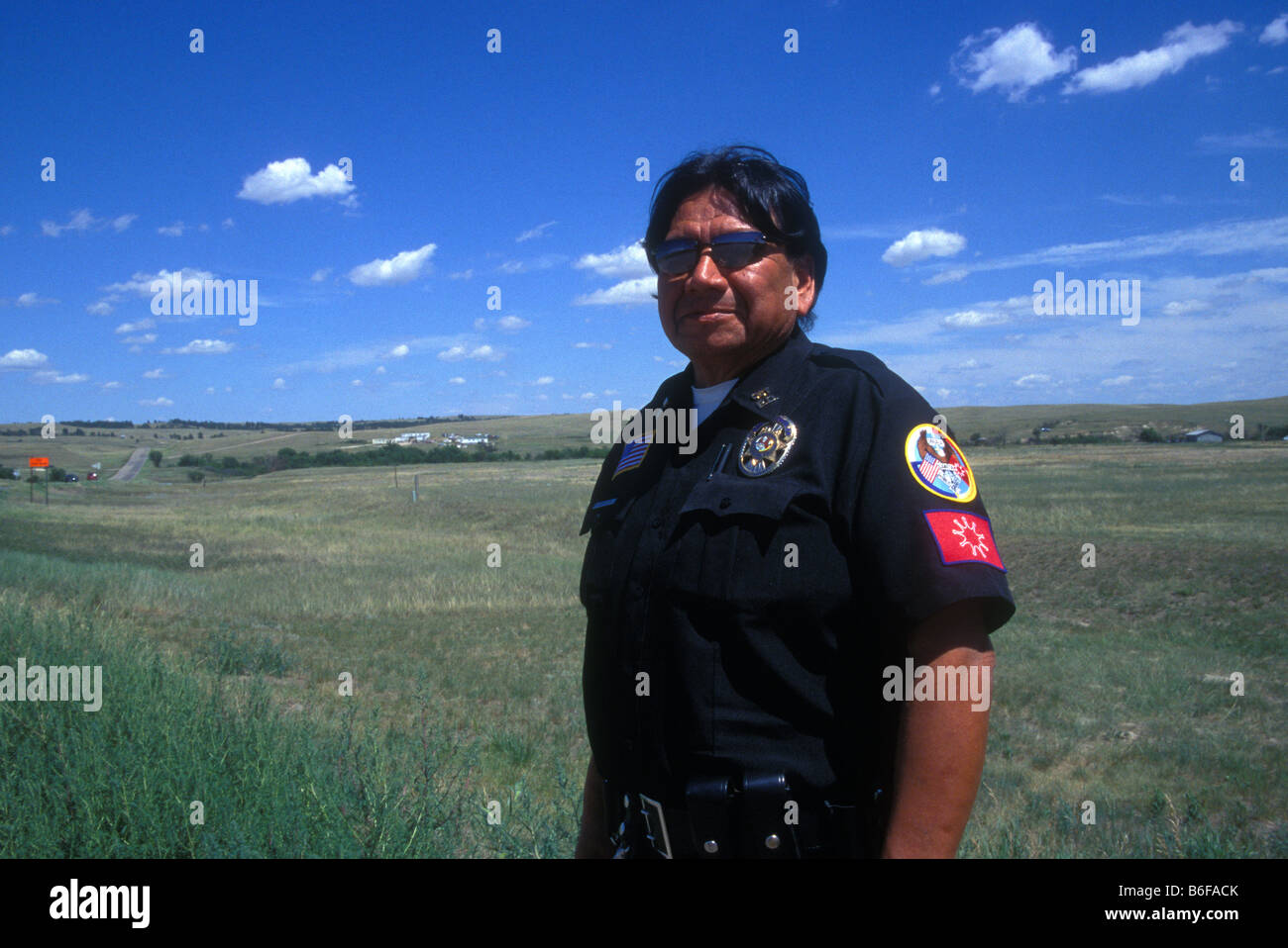 Oglala Sioux Indian police officer at Wounded Knee Pine Ridge Reservation South Dakota USA - Stock Image