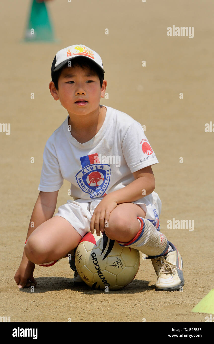 A child in football practice with a football club in Kyoto, Japan, Asia - Stock Image