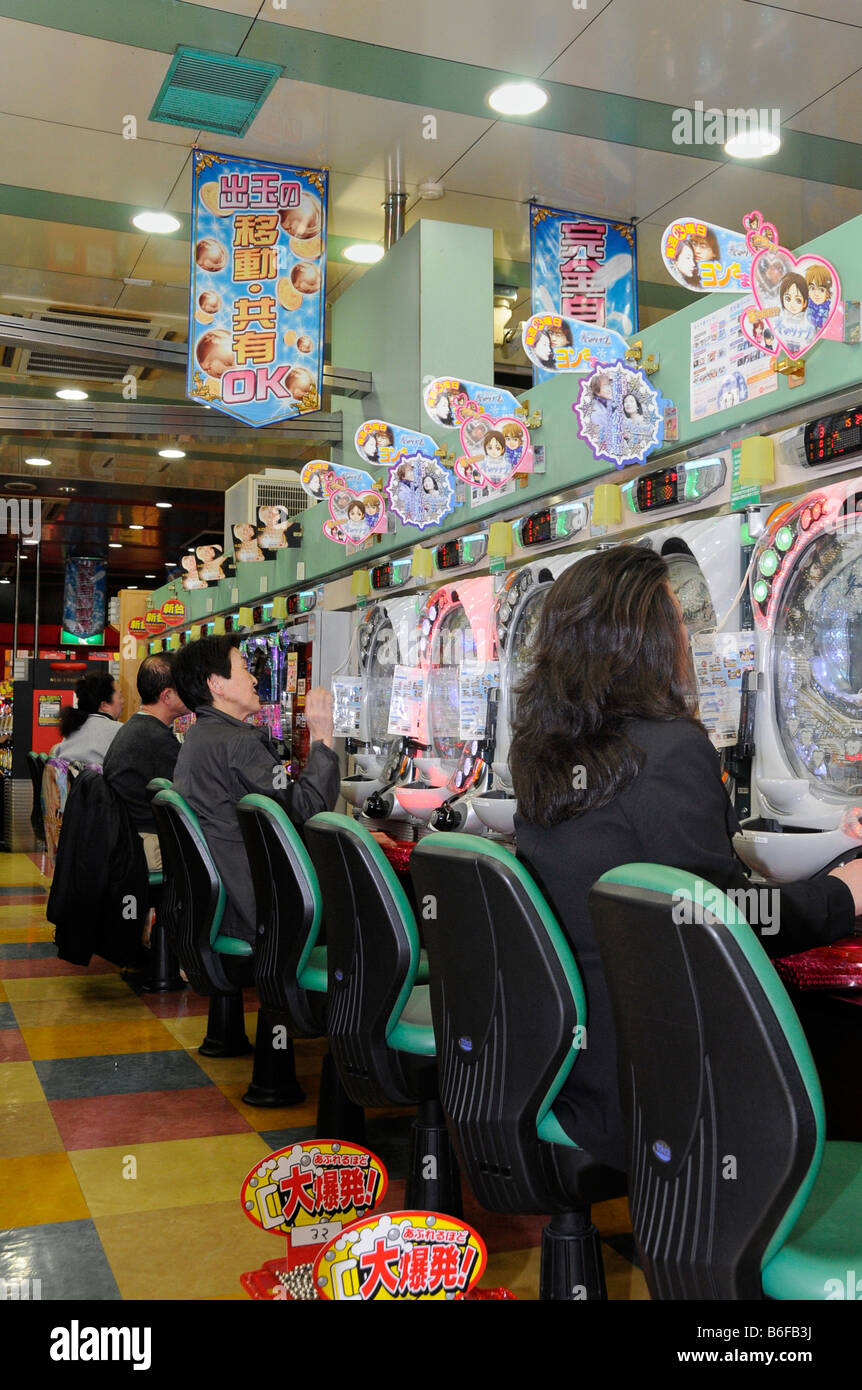 Japanese gambling on flipper game machines in a flipper gaming hall, Paschinko, in Kyoto, Japan, Asia Stock Photo