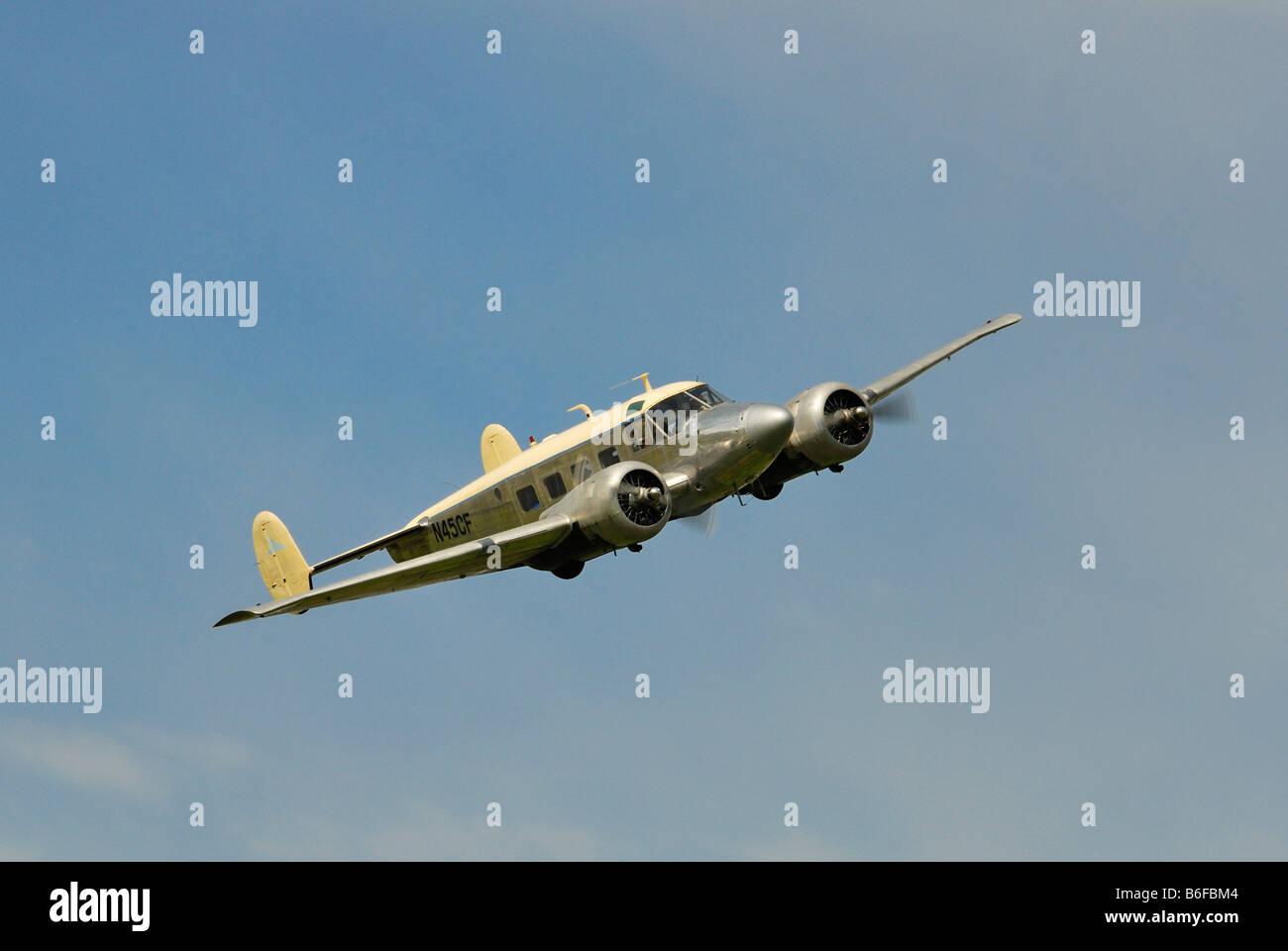 Beechcraft 18 Twin Beech during a deep flyover - Stock Image