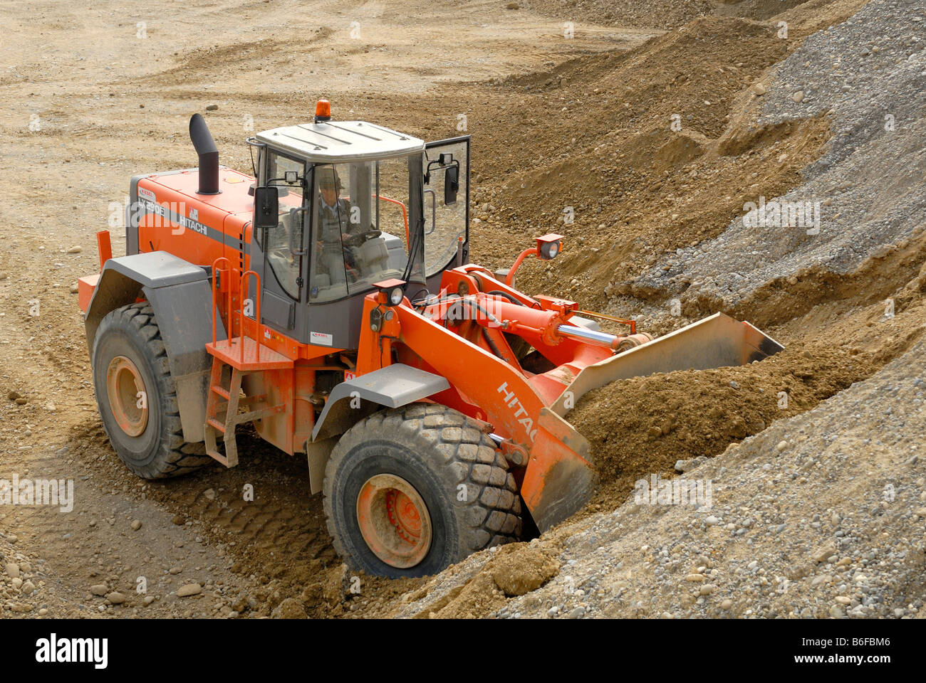 Hitachi LX 290E wheeled loader in a gravel pit - Stock Image