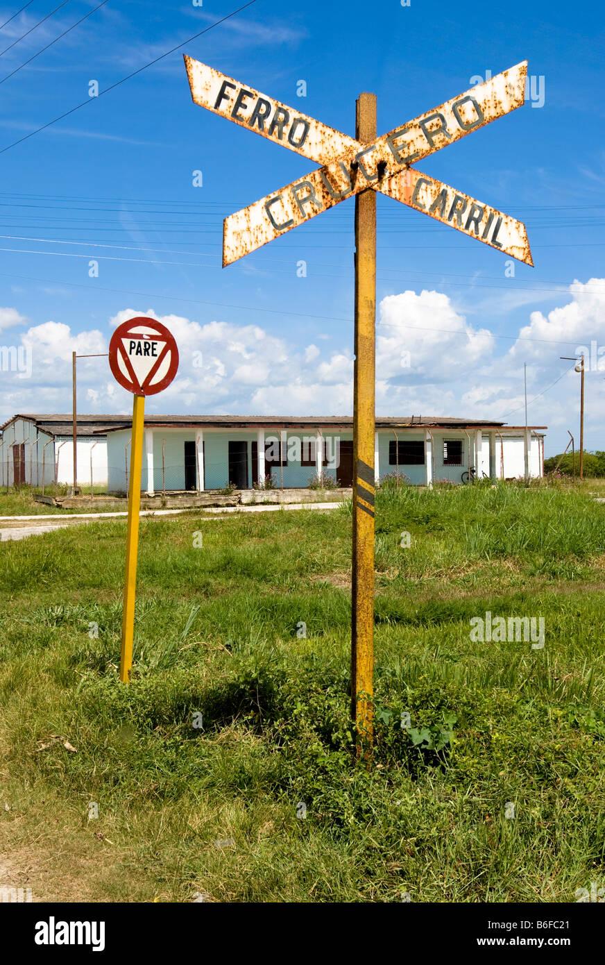 Warning sign for crossing the railway track, Sancti-Spíritus province, Cuba, Latin America Stock Photo