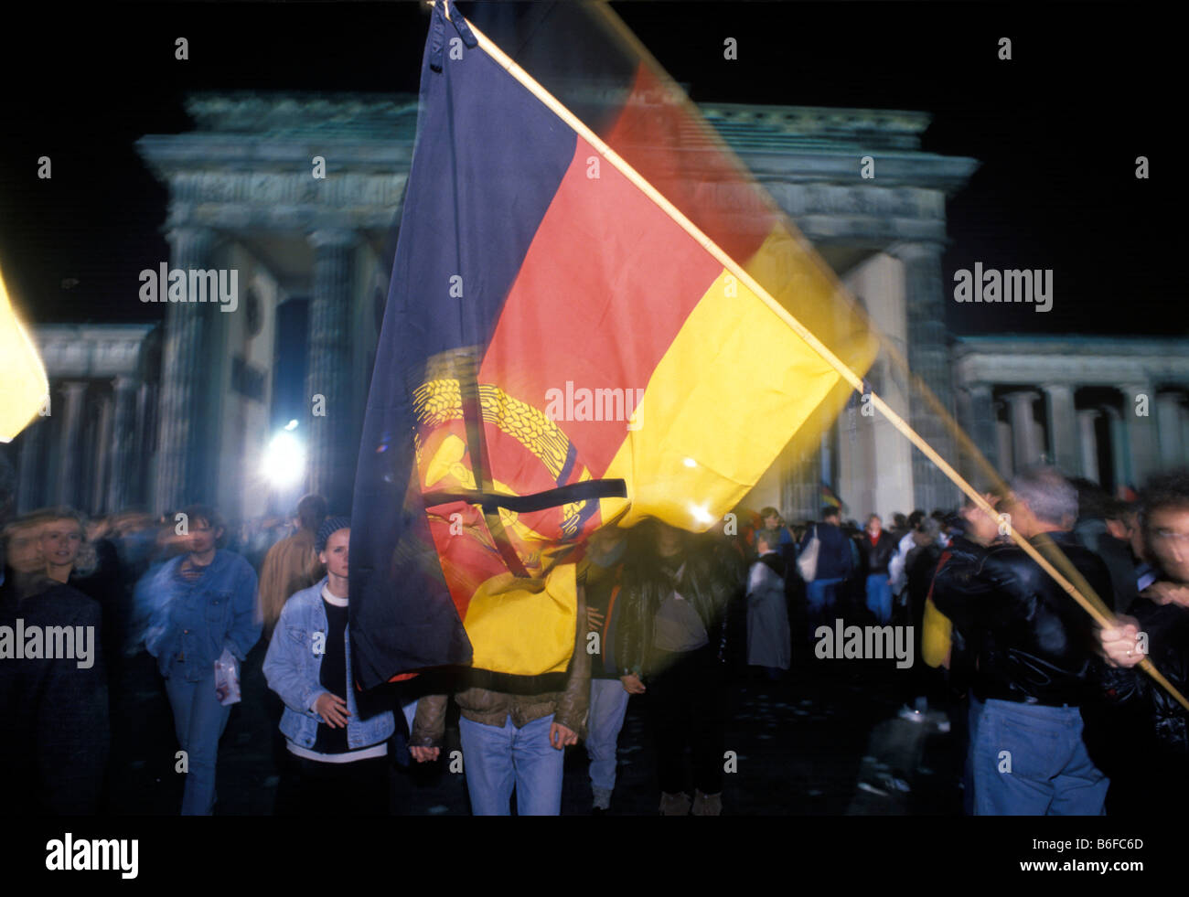 German Flag Citizens Of Berlin Celebrating The Reunion Of East And Stock Photo Alamy