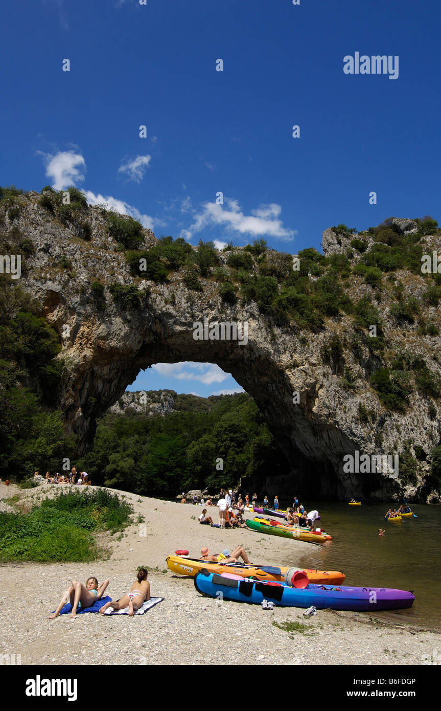 Kayaks beached beneath the natural rock arch, Vallon Pont d'Arc, on the Ardeche River, Ardeche, Rhone Alps, - Stock Image