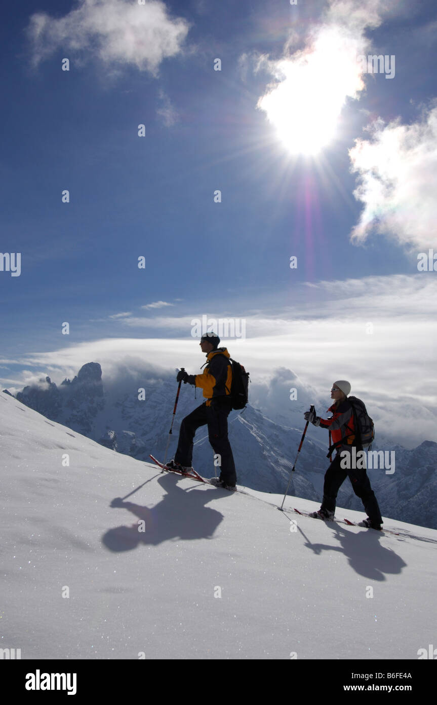 Snowshoe hikers on the Plaetzwiese Meadow in front of the Monte Cristallo Massif, High Puster Valley or Alto Pusteria, - Stock Image