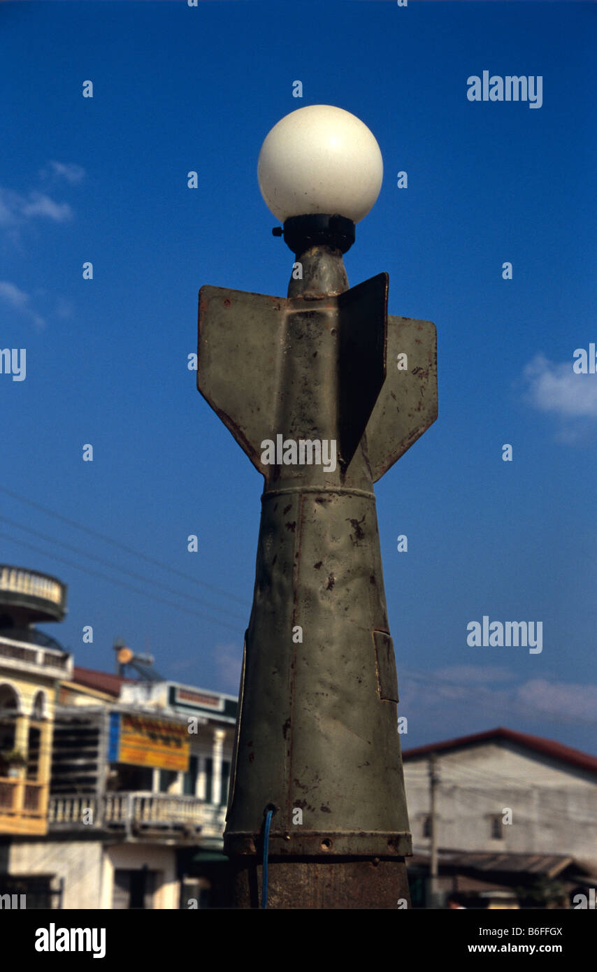 A public street light made from the casing of a US Vietnem War-era cluster bomb in the main strret of Phonsavan, - Stock Image