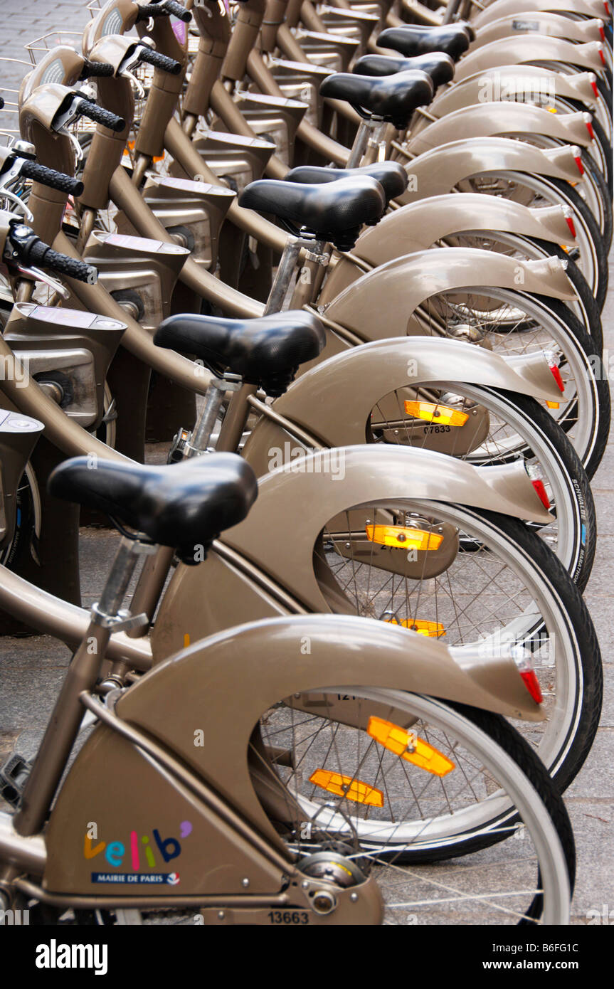 Lined-up bicycles, bicycle hire for residents and tourists, Paris, France, Europe - Stock Image