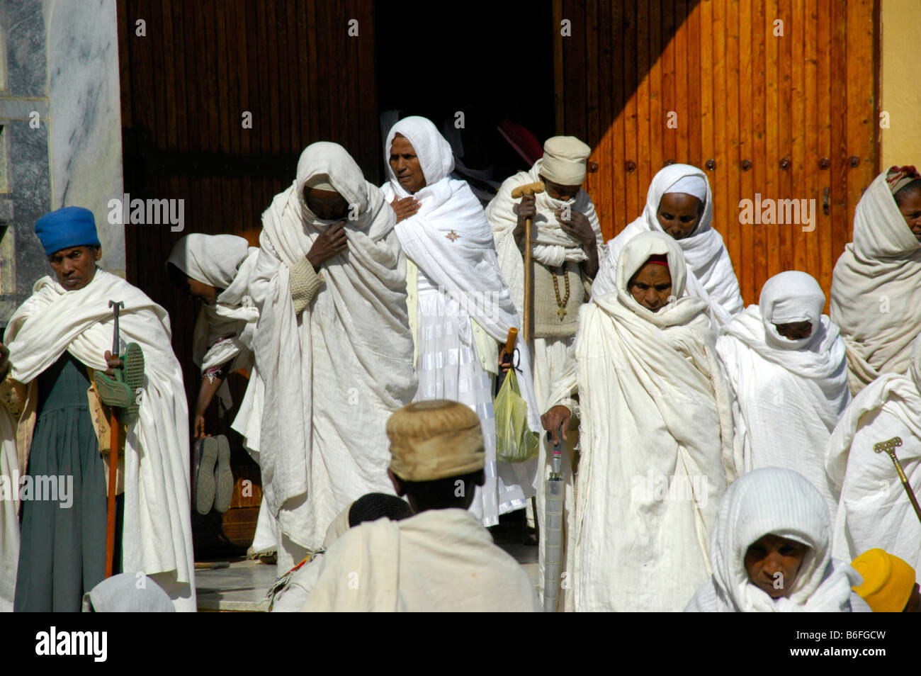 Believers of the Ethiopian Orthodox Church covered in white cloths in front of the new cathedral, Aksum, Ethiopia, - Stock Image