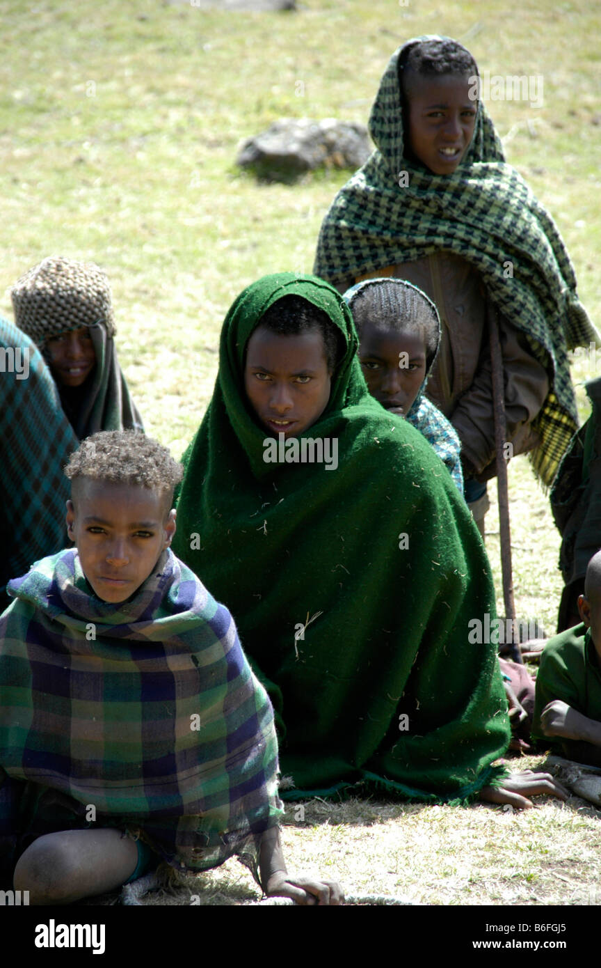 Poverty, people wearing shawls sitting on the ground, Semien Mountains, Ethiopia, Africa Stock Photo