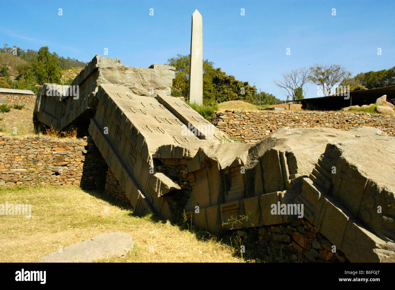 Toppeld and broken stela number 1 in the Stela Park in Axum, Ethiopia, Africa Stock Photo